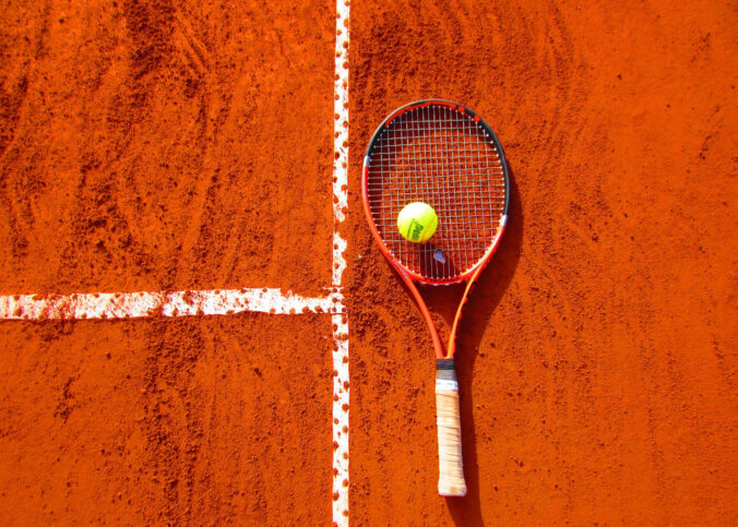 Tennis racket on tennis court